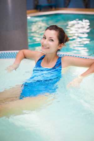 Picture of a girl relaxing in the swimming pool Stock Photo