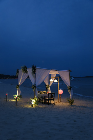 Romantic dinner table at the beach photo