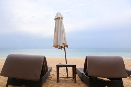 Two sunbeds on the beach in Thailand Stock Photo