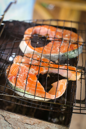 Picture of two pieces of salmon on a bbq grill