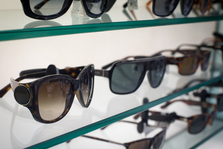 Sunglasses on the shelves in the shop