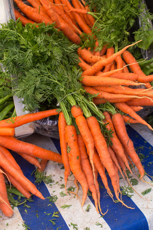Delicious bright carrots on the market Stock Photo