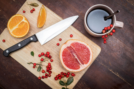 Coffee and fruits on the cutting board