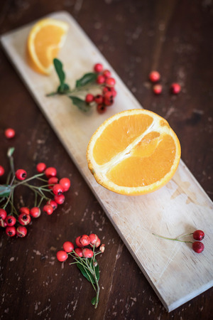 Oranges and berries on the table Stock Photo