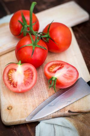 Fresh ripe tomatoes on the chopping board