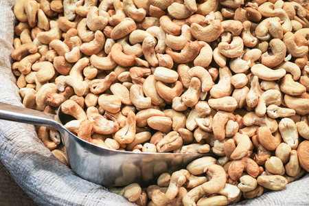 Big pile of indian cashew nuts on the market stall Stock Photo