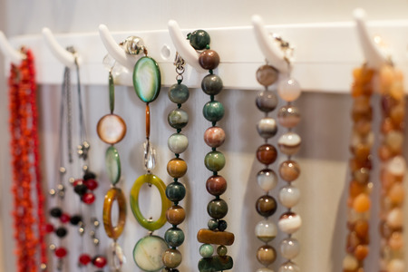 Beautiful colorful jewelry hanging on the wall
