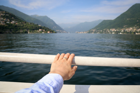Boat tour landscape on the background hand on the foreground Stock Photo