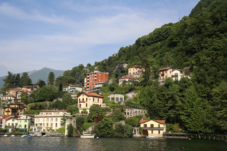 Beautiful little town in the mountains on the lake Como view from the lake Stock Photo