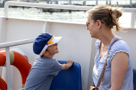 Mother and son taking a boat trip