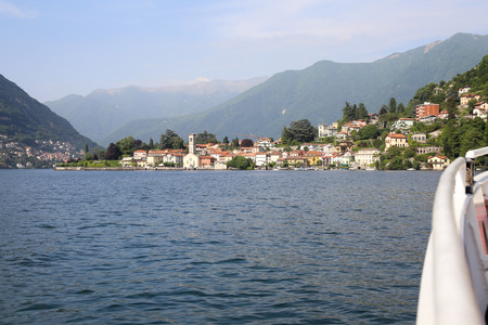 View of the little beautiful town on the lake Como from the boat Stock Photo