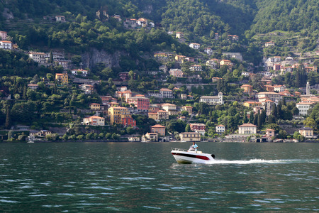 Motorboat on the beautiful lake landscape on lake Como