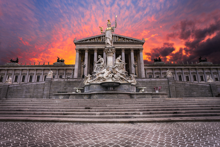 Facade of the Austrian parliament building in Vienna at sunset. The building is located on the Ringstraße in the centre of the city.