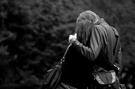 Romantic couple hugging each other in the park.
