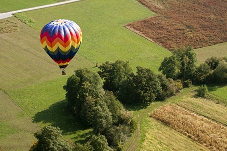 aeronautical: View on the colorful hot air balloon from above.