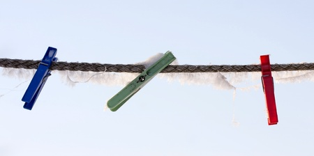 Frozen pegs on the wire. photo
