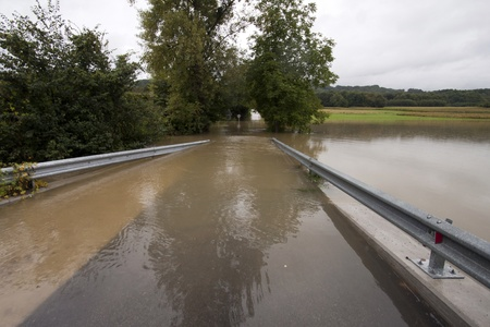 Road under the water in the floods.