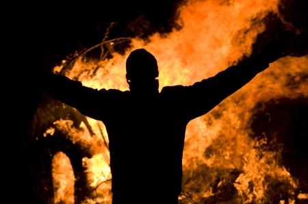 forest fire: Silhuette of the man running from the blazing flames.