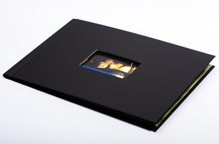 Photobook with black cover isolated on white.