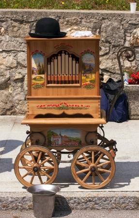 Old wooden music machine on wheels.