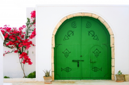Green gate in Arabic style. photo