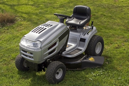 frontyard: Small tractor for cutting lawn on the grass