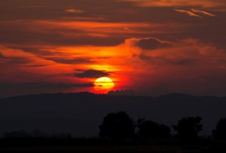 horizont: Beautiful burning sunset over the horizont Stock Photo