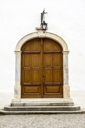massive: Massive entrance, wooden door of the castle.