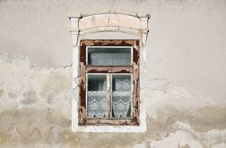 Weather worn wooden window on the house.