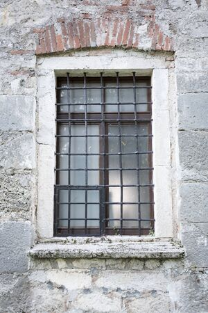 Old wooden window with iron bars Stockfoto