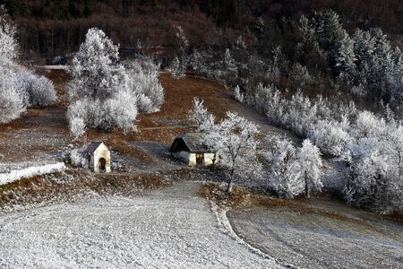 Cold winter morning over the landscape with white frost.