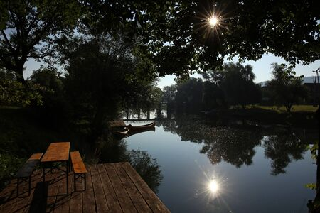 Beautiful summer sunrise by the river Krka, town Kostanjevica in Slovenia.