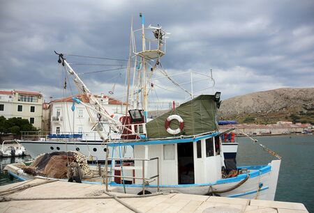 Small fishing boat at the dock in the town of Pag, Croatia.