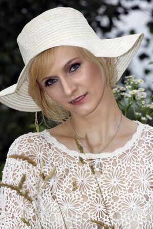 Portrait of beautiful blond woman with summer hat.