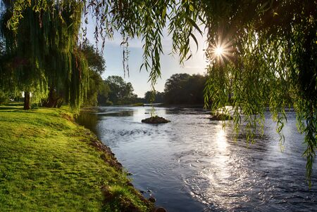 Beautiful summer sunrise by the river Krka in Slovenia.