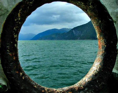 fjord view through hawse-hole Stok Fotoğraf - 354100