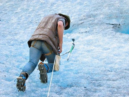 jostedal: Ice climber with ice-axe Stock Photo
