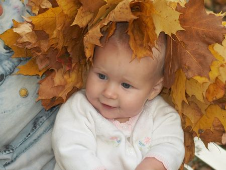 little girl in diadem from autumn maple leaves Stock Photo - 353988