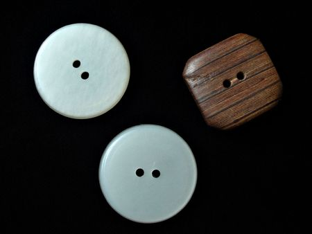 assorted buttons on black background photo