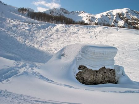 snowdrift: snowdrift on a stone