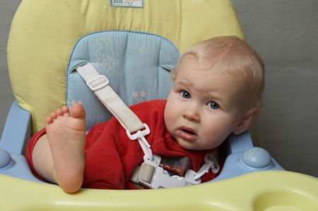 baby with his foot on the table photo