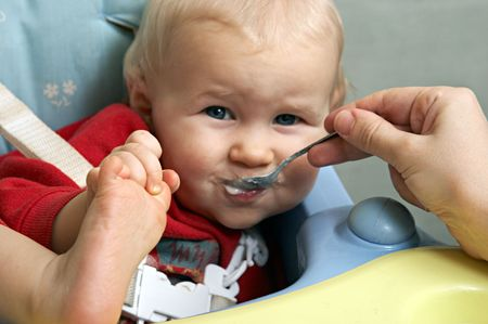 amusing baby with a spoon in a mouth Stock Photo - 356986