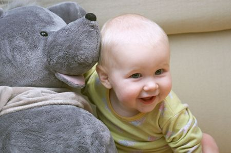 with fondness: little baby with big toy mouse