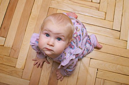 to creep: baby with funny face on all fours