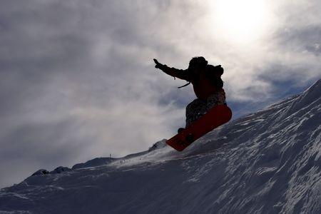 dark silhouette of flying snowboarder Stock Photo - 431288