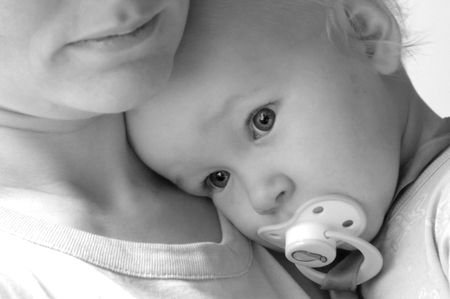 with fondness: baby on mothers shoulder  Stock Photo