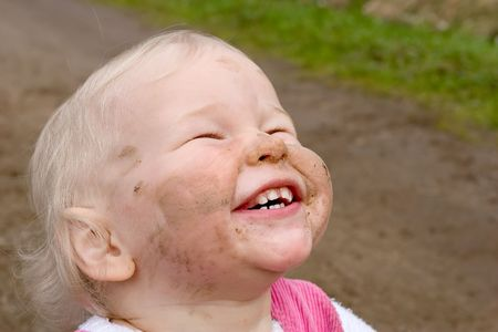amusing: dirty-faced child with amusing smile Stock Photo