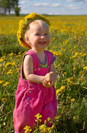 little smiling girl with dandelion diadem on a beautiful meadow Stock Photo - 431230