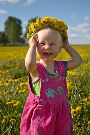 little smiling girl with dandelion wreath Stock Photo - 435823