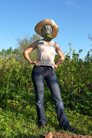 gasmask: woman in gas-mask on garden background